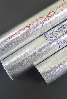 Упаковка и голографическим изображением. Печать: шелкография.